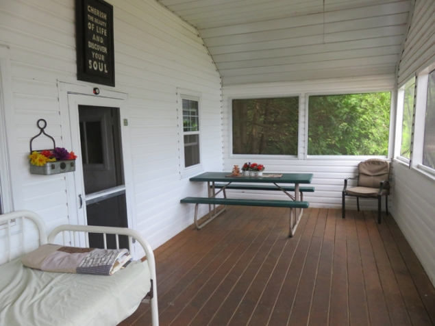 Spacious screened in front porch for eating lakeside.