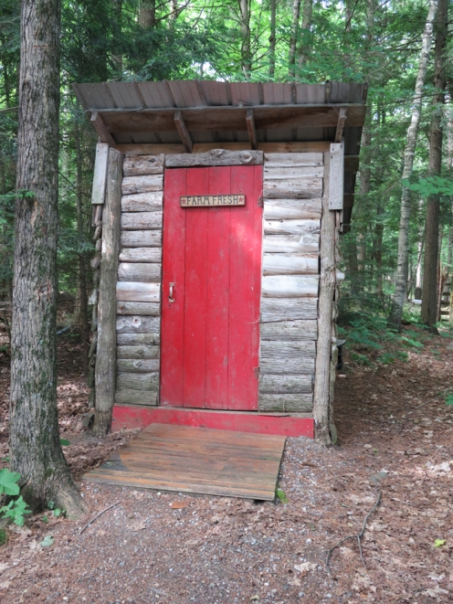 The outhouse is very close by - no woods to walk through.