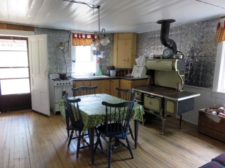 There is a propane stove and fridge as well as an old wood cookstove.